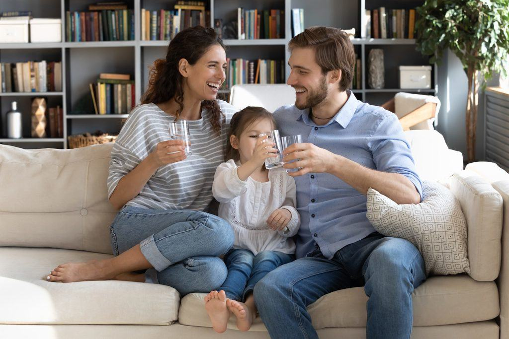 Family drinking pure filtered reverse osmosis water