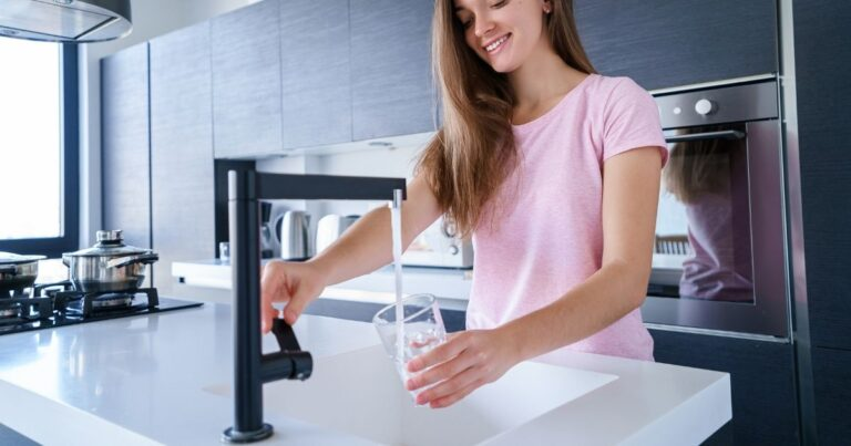 Woman drinking pure filtered water